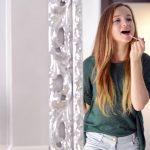 Beauty Teenage Girl applying Make up and admiring herself in the mirror.  Beautiful Teenager Looking in the Mirror at home and putting makeup on.