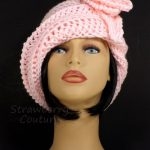 Art Deco Unique Ombretta Womens Soft Pink Crochet Cloche Hat for Flapper Girl with Rose Flower for Women in Soft Pink Acrylic Yarn