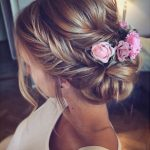 Braided hairstyles with flowers is beautiful for brides at weddings - Page 15 of 38