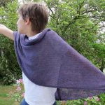 Knit a wide scarf in stockinette stitch – mine was approximately 23,5 inches w...