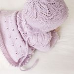 Knitted bonnet for babies with leaf pattern and garter stitch in DROPS Baby Meri...
