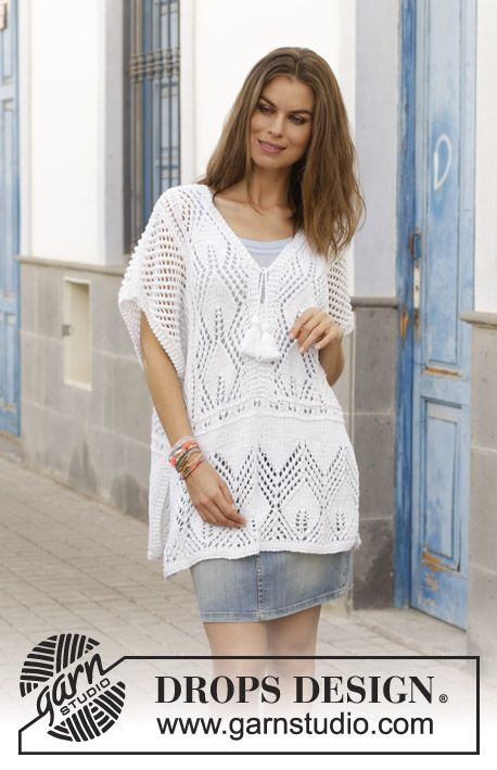Knitted tunic with lace pattern and vent in the sides. Size: S – XXXL Piece is k…