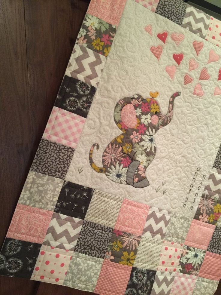Like the idea of a central image using scraps from blankies. Patchwork around ed