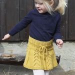 Sunny Hug / DROPS Children 30-20 - Children's skirt with lace pattern and croc...