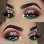 teal blue green under eye makeup lower lid orange red halo sparkly glitter eyesh...